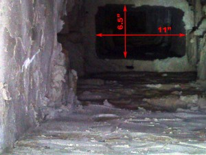 There is a narrow passage 6 feet below the top or the chimney (just below root level) that measures 6.75 by 11 inches